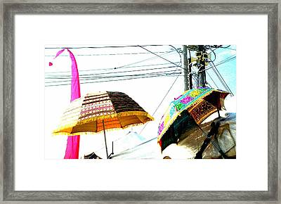 Umbrellas And Wires Framed Print