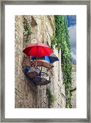 Umbrellas On The Balcony Framed Print by Nikolyn McDonald