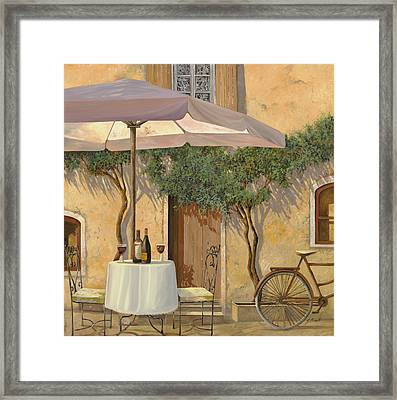 Un Ombra In Cortile Framed Print by Guido Borelli