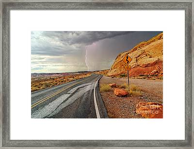 Uncertainty - Lightning Striking During A Storm In The Valley Of Fire State Park In Nevada. Framed Print by Jamie Pham