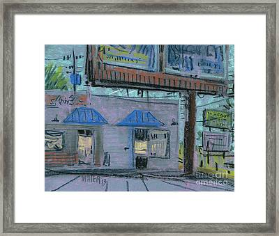 Under The Billboard Framed Print by Donald Maier