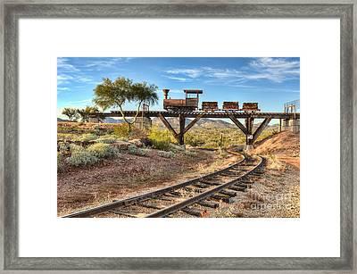 Under The Mining Cars Framed Print by Eddie Yerkish