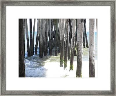Under The Pier Framed Print by Cheryl Smith