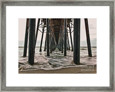 Under The Pier Framed Print by Eddie Yerkish