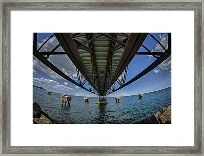 Under The Pier  Framed Print by Michael Demagall