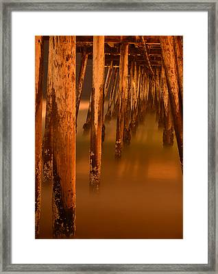 Under The Pier Framed Print by Mike Schmidt