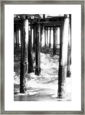 Under The Santa Monica Pier Framed Print by John Rizzuto