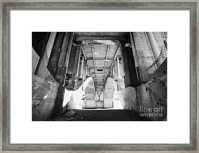 underneath the university bridge over the freezing south saskatchewan river Saskatoon Canada Framed Print by Joe Fox