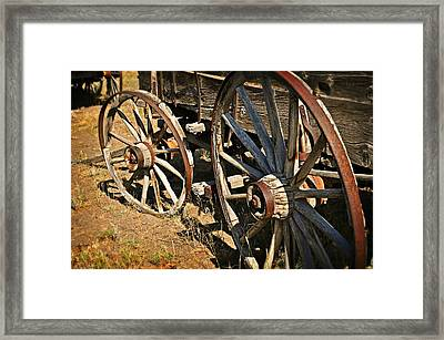 Unequal Wheels Framed Print