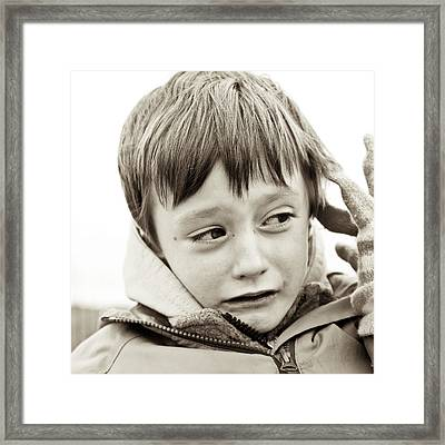 Unhappy Boy Framed Print by Tom Gowanlock