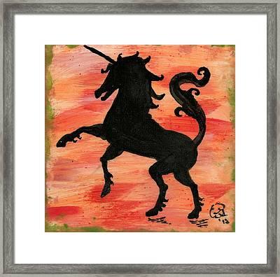 Unicorn At Play Framed Print by Gail Schmiedlin