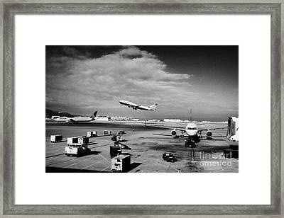 united airlines aircraft taking off taxiing and on stand at the San Francisco International Airport  Framed Print