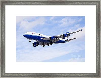 United Airlines Boeing 747 Airplane Flying Framed Print by Paul Velgos