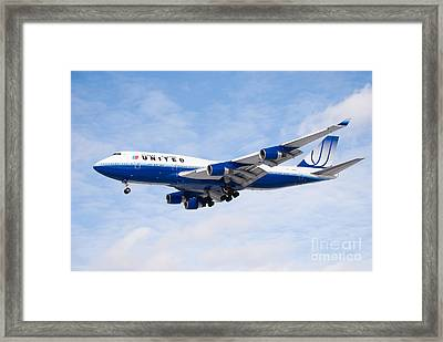 United Airlines Boeing 747 Airplane Landing Framed Print by Paul Velgos