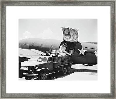 Unloading Cargo From A U.s. Army Air Framed Print by Stocktrek Images