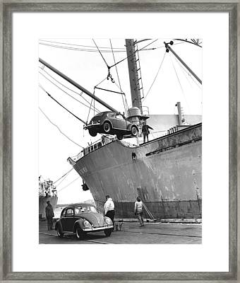 Unloading Volkswagons Framed Print by Underwood Archives