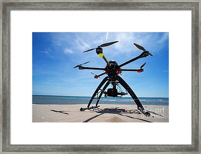 Unmanned Aerial Vehicle On Beach Framed Print by Sami Sarkis