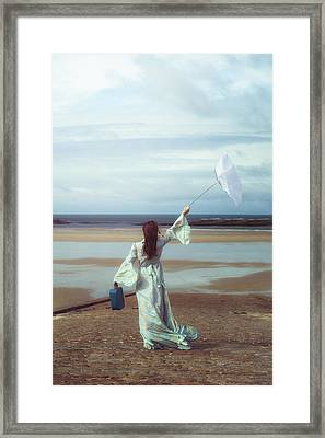 Upended Umbrella Framed Print by Joana Kruse