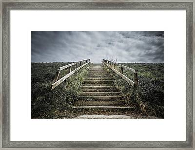 Uphill Battle Framed Print by Charlie Tash