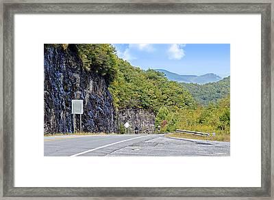 Uphill Downhill Framed Print by Susan Leggett