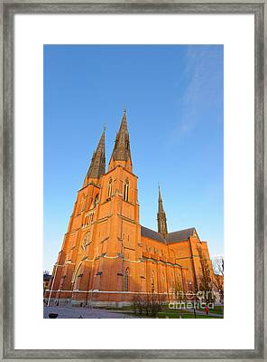 Uppsala Cathedral In Sweden - Glowing In The Evening Light Framed Print