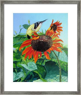 Upside Down Delight-goldfinch On Sunflower Framed Print by Bonnie Mason