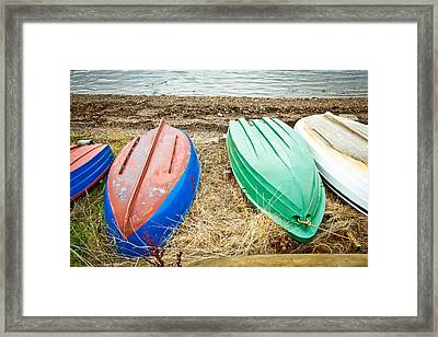 Upturned Boats Framed Print by Tom Gowanlock