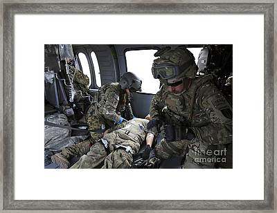 U.s. Army Flight Medics Aid A Simulated Framed Print by Stocktrek Images