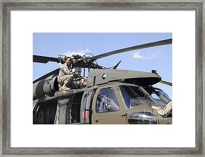 U.s. Army Pilot Conducts Pre-flight Framed Print by Stocktrek Images