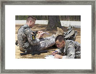 U.s. Army Rangers Map Out Their Route Framed Print