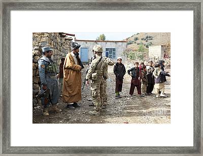 U.s. Army Soldier And An Afghan Uniform Framed Print by Stocktrek Images