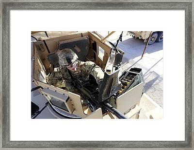 U.s. Army Soldier Checks A Mk-19 Framed Print