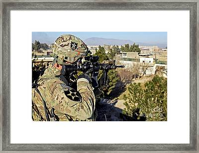 U.s. Army Soldier Scans For Security Framed Print by Stocktrek Images