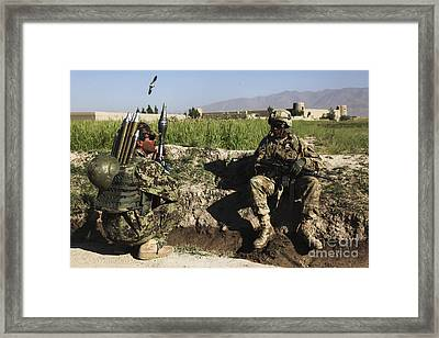 U.s. Army Soldier Takes A Break With An Framed Print