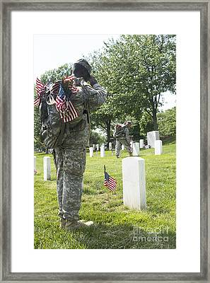 U.s. Army Soldiers Place Flags In Front Framed Print