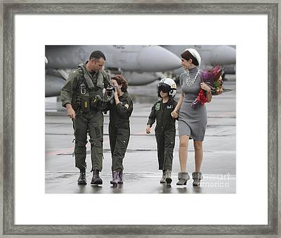 U.s. Aviator Walks With His Family Framed Print by Stocktrek Images