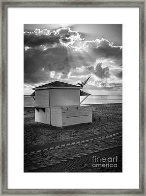 Us Flag On Beach Hut Illuminated By Early Morning Sun - Black And White Framed Print by Ian Monk