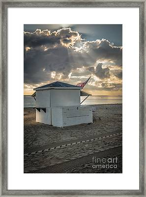 Us Flag On Beach Hut Illuminated By Early Morning Sun Framed Print by Ian Monk