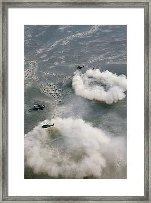 Us Helicopters Landing In Afghanistan Framed Print by U.s. Marine Corps
