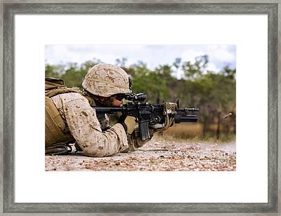 U.s. Marine Fires Rounds Down Range Framed Print by Stocktrek Images