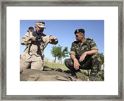 U.s. Marine Learns The Details Framed Print by Stocktrek Images