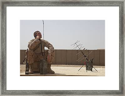 U.s. Marine Looks Up To The Sky While Framed Print by Stocktrek Images