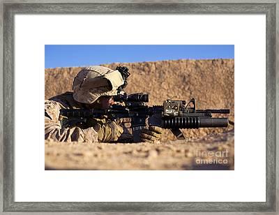U.s. Marine Scans For Threats Framed Print by Stocktrek Images