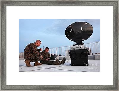 U.s. Marines Set Up A Satellite System Framed Print by Stocktrek Images