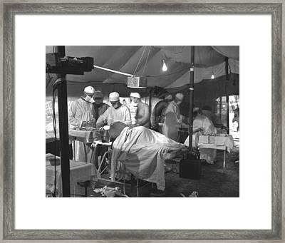 U.s. Navy Doctors And Corpsmen Operate Framed Print by Everett