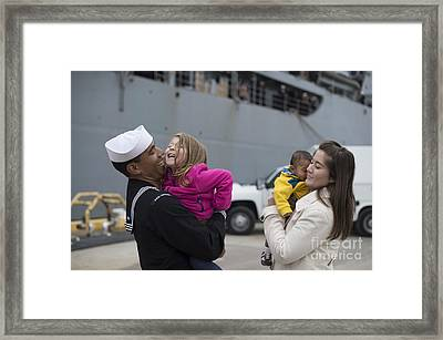 U.s. Navy Sailor Greets His Family Framed Print by Stocktrek Images