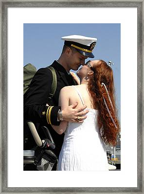 U.s. Navy Sailor Holds His Wife Framed Print by Stocktrek Images