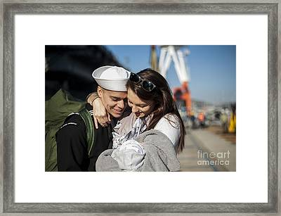 U.s. Navy Sailor Hugs His Wife Framed Print by Stocktrek Images