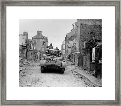 U.s. Tank Advancing Through The Ruins Framed Print by Everett