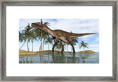 Utahraptor Standing In Shallow Water Framed Print by Kostyantyn Ivanyshen